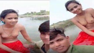 Topless Desi village girl enjoying outdoor bathing on selfie cam
